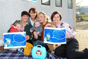 Raising awareness: Health Visitor Clare Walsh, Health Visiting Manager Deirdre Ward and Cathrine Reid, Head of Service for GP Out of Hours, with Emma Murtagh and her children Pippa and Henry.