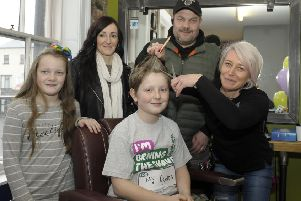 """Dromore Central pupil Tyler Whitten """"Braved The Shave"""" for his Granda in aid of Macmillan Cancer Support, ready for the first cut is Cheryl of The B-Hive Barber in Dromore, included is Tyler's Dad Colin, Mum Lyndsey and sister Kayla �Edward Byrne Photography INBL1814-201EB"""