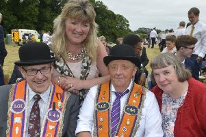 Councillor Frances Burton with Sidney Oliver, William Reid and Sandra Reid enjoying a sit-down in the field at Ballygawley