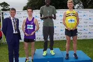 Kenyan FreddieSittuk takes top spot on the podium at the Waterside Half Marathon fro North Belfast Harriers' AndrewAnnett in second and Foyle Valley's Scott Rankin in third.
