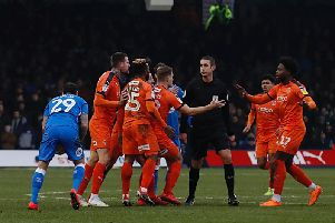 Luton players react to the challenge on Andrew Shinnie at the weekend