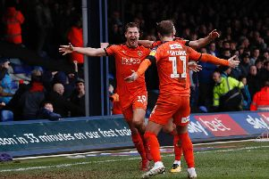 James Collins celebrates putting Luton on their way to equalling the club record of undefeated games in the Football League on Saturday