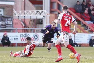 Andrew Shinnie is fouled by Fleetwood defender Jason Holt on Saturday