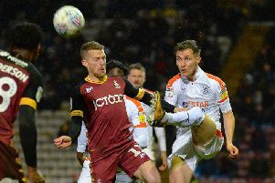 Dan Potts clears the danger at Bradford on Tuesday night