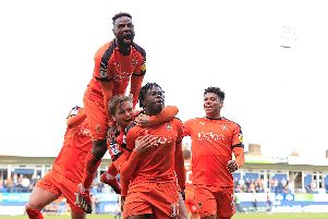 Pelly-Ruddock Mpanzu celebrates his opening goal against Doncaster