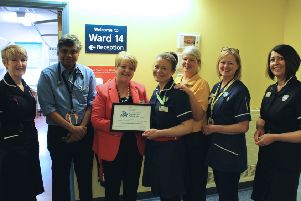 Staff from the hospital with the certificate from Luton Dementia Action Alliance