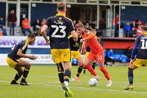 Midfielder Andrew Shinnie has extended his deal with Luton
