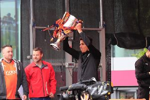 James Justin lifts the League One trophy