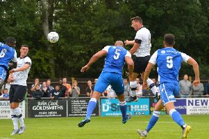 Matty Pearson heads for goal at Bedford Town
