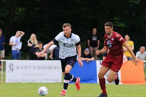 Ryan Tunnicliffe moves away from an opponent