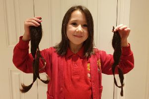 Caitlin with her hair for the Little Princess Trust