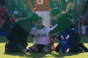 Harry Cornick gets treatment against Nottingham Forest yesterday