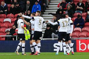 Luton players celebrate Ryan Tunnicliffe's winner at Middlesbrough this afternoon