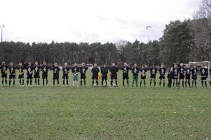 The players line up before the game