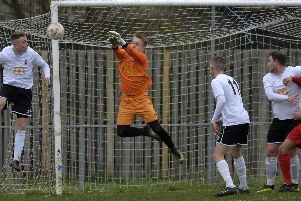 Eastbourne United defend a Hassocks attack
