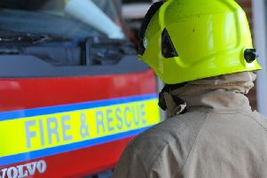 A man has been rescued from a fire in a high-rise block of flats in Sussex.