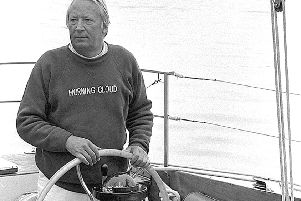 Premier Edward Heath at the wheel of his yacht Morning Cloud. Picture: Tim King.
