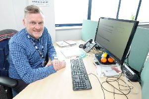 Staff at The Silver Line, a national helpline for older people.  Pictured is volunteer coordinator Kenny Dale. SUS-180523-164312001
