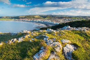 View from the top of the limestone headland ridge The Great Orme, to Llandudno historic seaside resort and waterfront in North Wales.'VisitBritain/ Lee Beel;