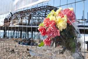Flowers left at the pier as a tribute to the construction worker from cumbria that lost his life'Stephen Penrice SUS-140821-142424001