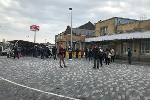 Rail passengers pictured outside Eastbourne railway station this morning (April 24)