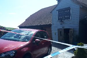 A car crashed into the pub this afternoon