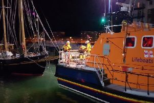 Eastbourne lifeboat crews assisting the stranded ship. Picture by Carl Pocock