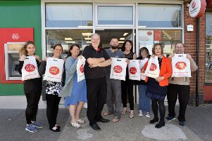 Paul Money is the new postmaster at 326 Seaside, Eastbourne. Pictured here with local business people (Photo by Jon Rigby) SUS-190515-131056008