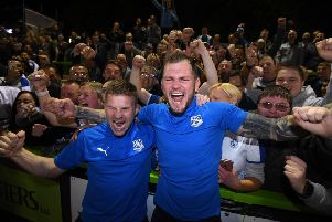 NAILSWORTH, ENGLAND - MAY 13: Jay Harris of Tranmere Rovers (L) celebrates with James Norwood of Tranmere Rover during the Sky Bet League Two Play-off Semi Final Second Leg match between Forest Green and Tranmere Rovers at The New Lawn on May 13, 2019 in Nailsworth, United Kingdom. (Photo by Harry Trump/Getty Images) SUS-190516-111810002