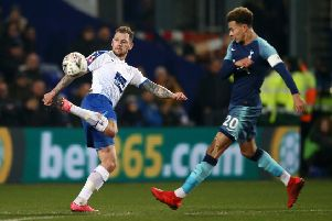 BIRKENHEAD, ENGLAND - JANUARY 04:  James Norwood of Tranmere Rovers in action while under pressure from Dele Alli of Tottenham Hotspur during the FA Cup Third Round match between Tranmere Rovers and Tottenham Hotspur at Prenton Park on January 4, 2019 in Birkenhead, United Kingdom.  (Photo by Jan Kruger/Getty Images) SUS-190804-172940002