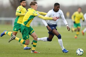 NORWICH, ENGLAND - JANUARY 18:  Shilow Tracey of Tottenham Hotspur is pulled back by Ciaren Jones of Norwich City during the Premier League International Cup match between Norwich City and Tottenham Hotspur U23 on January 18, 2019 in Norwich, England. (Photo by Paul Harding/Getty Images) SUS-190606-110945002