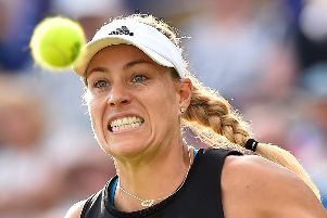 Germany's Angelique Kerber returns against Australia's Samantha Stosur during their women's second round match at the WTA Nature valley International tennis tournament in Eastbourne, southern England on June 25, 2019. (Photo by Glyn KIRK / AFP)        (Photo credit should read GLYN KIRK/AFP/Getty Images) SUS-190626-172229002