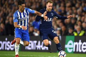 Markus Suttner battles with Christian Eriksen. Picture courtesy of Getty Images