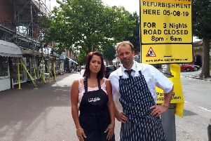 Nigel Heath of Heath and Son butchers and Annabelle Fontaine of The Dolls House hairdressers are concerned about roadworks affecting parking in Green Street, Eastbourne