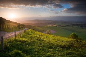 Stunning landscape at sunset over rolling English countryside SUS-191109-091538001