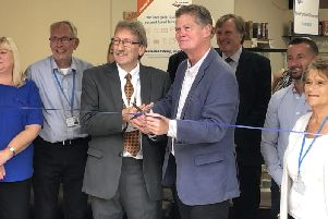 Age Uk store re-opening Langney. Stephen Llyod, MP, councillor Alan Shuttleworth, staff and trustees pictured.