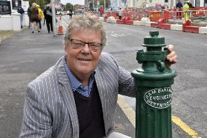 Richard Crook with the refurbished water hydrant in Gidredge Road, Eastbourne (Photo by Jon Rigby) SUS-190926-092304008