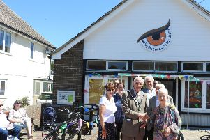 Dame Jacqueline Wilson with Chairman John Pritchett and members of the Willingdon Residents Association at the opening of Willingdon Library SUS-190627-090620001