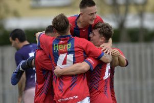 Eastbourne United players celebrate a goal during Saturday's 3-1 win over Alfold. Picture courtesy of Jon Rigby.