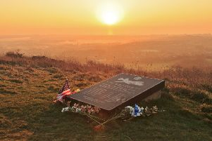 The sun rising over the Ruth-Less war memorial on Butts Brow, by Barry Davis. This photograph of the memorial to the American airmen who died when their aircraft crashed into the South Downs during World War Two was taken with a Canon 5d iii. SUS-190803-104422001
