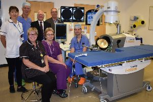 Urology staff with the lithotripter along with Simon Mackie and Bob Lewis from the Medi Tech Trust SUS-191021-113125001