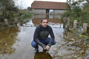 Buzz Active general manager Richard Wilson at their flooded premises at Exceat (Photo by Jon Rigby) SUS-191024-105845008