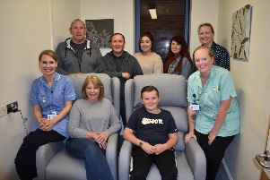 Berwick ward staff with Michelle Lewis with her family on the two new reclining chairs they donated