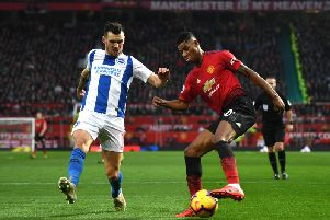Brighton and Hove Albion's Pascal Gross closes in on Manchester United's Marcus Rashford