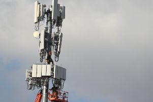5G equipment being installed on a phone mast (Photo by George Frey/Getty Images) 775443377
