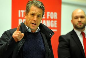 Hugh Grant campaigning alongside Labour candidate for Crawley, Peter Lamb. Photo: Steve Robards