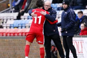 Danny Bloor embraces Eastbourne Borough winger Nick Wheeler. Picture by Lydia Redman