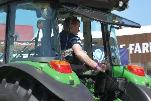 YFCU member demonstrating his tractor skills in the machinery handling competition