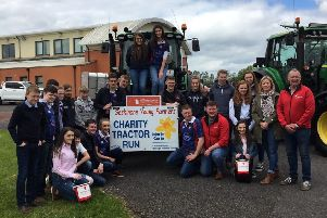 Seskinore Young Farmers' Club pictured in front of the lead tractor that was in aid of Marie Curie and Air Ambulance NI