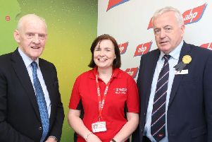 Larry Goodman and Gerry Melott from ABP with Breige Mulholland from Air Ambulance NI